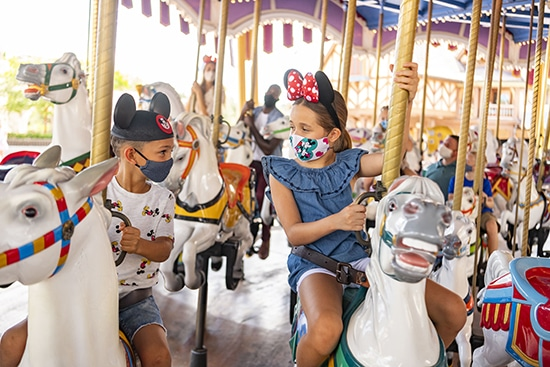Children with Masks Riding on Prince Charming Carousel at Walt Disney World